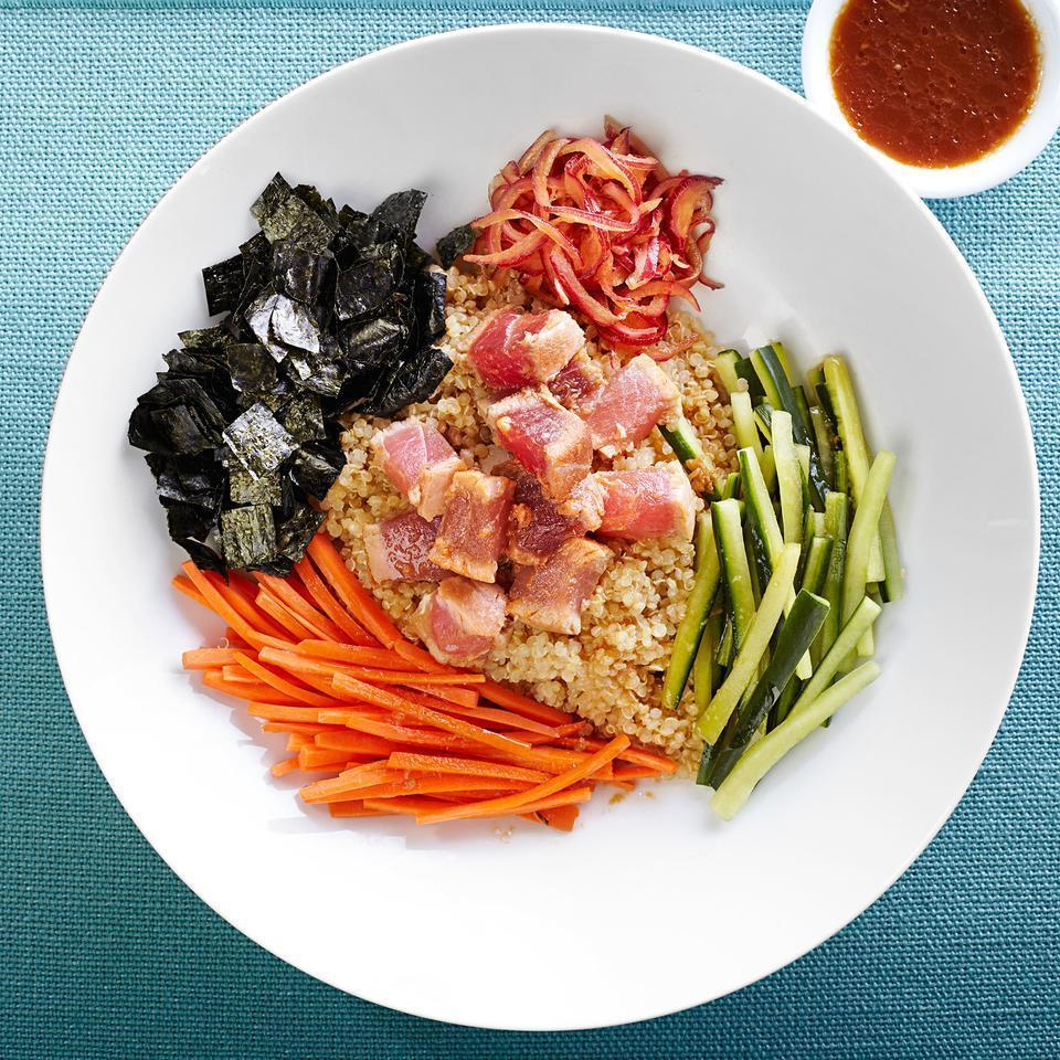 "<p>In this healthy tuna and quinoa recipe, tuna steaks are flash-cooked, sliced, then tossed in a quick, gingery marinade. The tuna, vegetables and seaweed get dressed with some of the flavor-packed tataki marinade and served over protein-rich quinoa. <a href=""http://www.eatingwell.com/recipe/250940/seared-tuna-tataki-quinoa-bowl/"" rel=""nofollow noopener"" target=""_blank"" data-ylk=""slk:View recipe"" class=""link rapid-noclick-resp""> View recipe </a></p>"