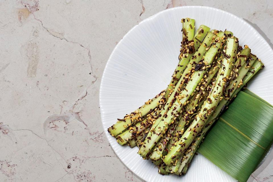 "This is one of our <a href=""https://www.epicurious.com/holidays-events/celery-sticks-bar-goto-sesame-furikake-snack-article?mbid=synd_yahoo_rss"" rel=""nofollow noopener"" target=""_blank"" data-ylk=""slk:all-time favorite"" class=""link rapid-noclick-resp"">all-time favorite</a> celery recipes. It only requires 5 ingredients, but it's worth careful attention. Removing the stringy bits from the exterior of each stalk using a vegetable peeler gives you pure crunch without any fibers sticking between your teeth. <a href=""https://www.epicurious.com/recipes/food/views/kombu-celery?mbid=synd_yahoo_rss"" rel=""nofollow noopener"" target=""_blank"" data-ylk=""slk:See recipe."" class=""link rapid-noclick-resp"">See recipe.</a>"
