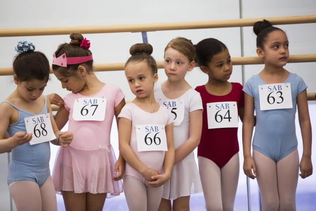 Children stand as they wait for their turn during an audition for the School of American Ballet in New York April 25, 2014. The school is holding auditions for over 600 beginner ballet students, who will be selected to fill the 120 spots available to study on campus. REUTERS/Lucas Jackson (UNITED STATES - Tags: SOCIETY EDUCATION TPX IMAGES OF THE DAY)
