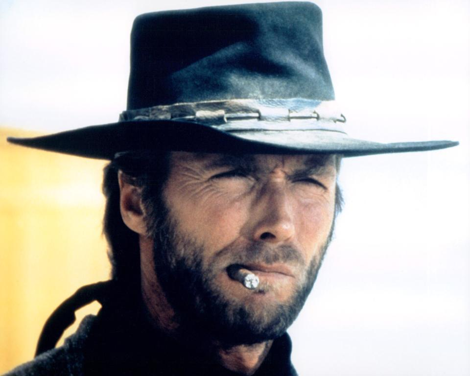 Headshot of Clint Eastwood, US actor, in costume, smoking a cigar in a publicity portrait issued for the film, 'High Plains Drifter', USA, 1973. The Western, directed by Clint Eastwood who also starred as 'The Stranger'. (Photo by Silver Screen Collection/Getty Images)