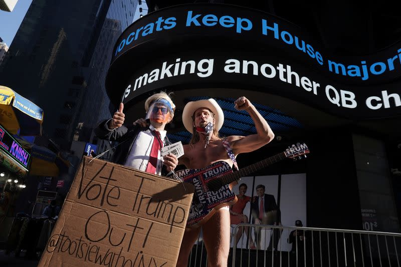 "Robert Burck, better known as the ""Naked Cowboy"" poses for a picture in Times Square"