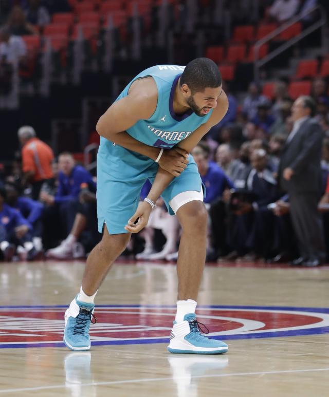 "The Hornets' <a class=""link rapid-noclick-resp"" href=""/nba/players/4487/"" data-ylk=""slk:Nicolas Batum"">Nicolas Batum</a> holds his arm during the first half of Wednesday's preseason game against Detroit. (AP Photo/Carlos Osorio)"