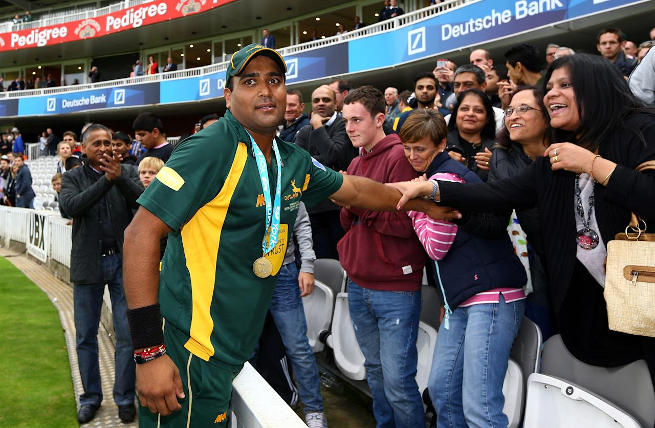 LONDON, ENGLAND - SEPTEMBER 21: Samit Patel of Nottinghamshire celebrates the win with family and friends after the Yorkshire Bank 40 Final match between Glamorgan and Nottinghamshire at Lord's Cricket Ground on September 21, 2013 in London, England. (Photo by Jan Kruger/Getty Images)