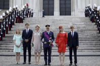 Belgium's Royal Family, from left, Princess Eleonore, Prince Gabriel, Queen Mathilde, King Philippe, Crown Princess Elisabeth and Prince Emmanuel leave after a religious service at the St. Gudula cathedral in Brussels, Wednesday, July 21, 2021. Belgium celebrates its National Day on Wednesday in a scaled down version due to coronavirus, COVID-19 measures. (AP Photo/Olivier Matthys)