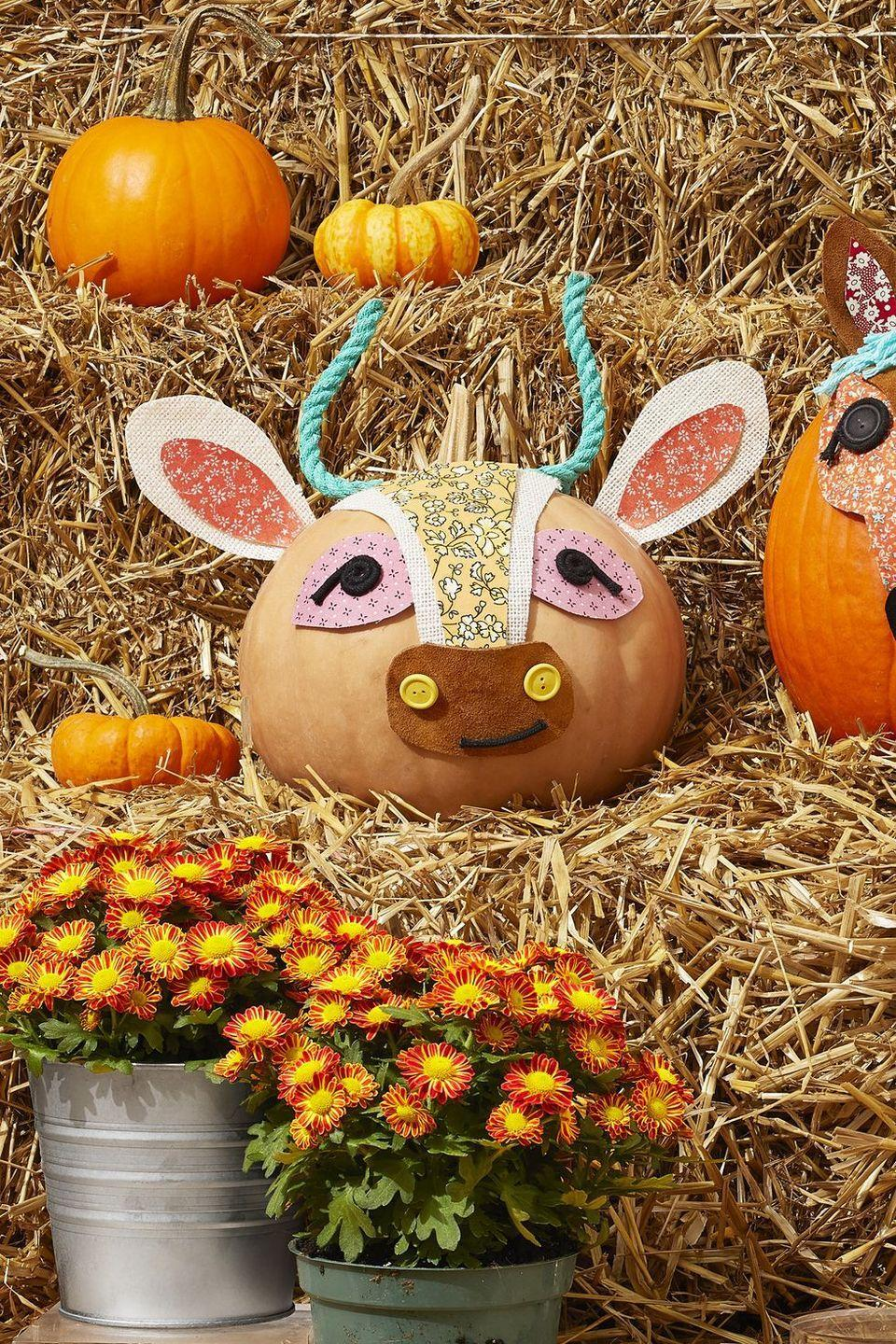 """<p><em>Moo</em>-ve over, plain pumpkins!Arrange pieces of floral fabric on a white or neutral-toned pumpkin to create this cow's ears, nose, and eyes, then stick them to pieces of burlap and hot glue on. Use buttons to dress up the nose and black cotton cord to form the eyes.</p><p><a class=""""link rapid-noclick-resp"""" href=""""https://go.redirectingat.com?id=74968X1596630&url=https%3A%2F%2Fwww.walmart.com%2Fip%2FBlack-Waxed-Cotton-cord-2mm-100-meters%2F704851905&sref=https%3A%2F%2Fwww.thepioneerwoman.com%2Fhome-lifestyle%2Fdecorating-ideas%2Fg36664123%2Fwhite-pumpkin-decor-ideas%2F"""" rel=""""nofollow noopener"""" target=""""_blank"""" data-ylk=""""slk:SHOP BLACK WAXED COTTON CORD"""">SHOP BLACK WAXED COTTON CORD</a></p>"""