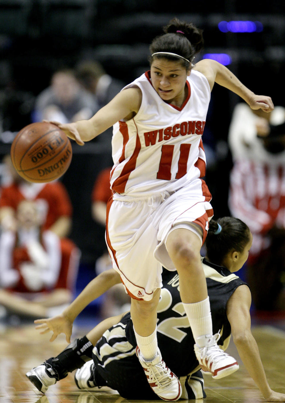 """FILE - In this Friday, March 5, 2010 file photo, Wisconsin guard Rae Lin D'Alie, front, make steals the basketball from Purdue guard KK Houser during the first half of an NCAA college basketball game in the second round of the Women's Big Ten NCAA conference tournament in Indianapolis. Rae Lin D'Alie was born and raised in Wisconsin but is the star of Italy's 3-on-3 basketball team at the Tokyo Olympics. """"Rae Rae"""" as she is known usually is the shortest player on the court at 5-foot-3 but is Italy's spark plug and court general. (AP Photo/Darron Cummings, File)"""