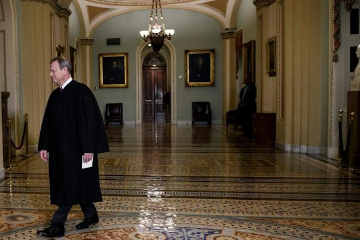 Supreme Court Chief Justice John Roberts, seen entering the US Senate to convene the court of impeachment, will preside over the impeachment trial of President Donald Trump (AFP Photo/Brendan Smialowski)