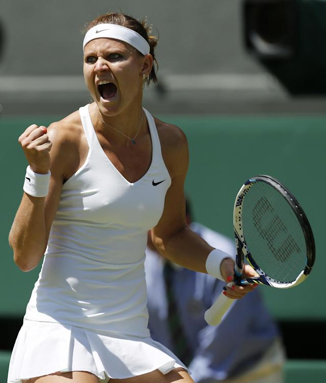 Lucie Safarova of Czech Republic celebrates after winning a point against Petra Kvitova of Czech Republic during their women's singles semifinal match at the All England Lawn Tennis Championships in Wimbledon, London, Thursday, July 3, 2014. (AP Photo/Ben Curtis)