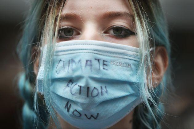 SYDNEY, AUSTRALIA - MAY 21: A climate activist wears a face mask at Town Hall during the School Strike 4 Climate rally on May 21, 2021 in Sydney, Australia. School Strike 4 Climate rallies are being held across Australia, with students protesting government inaction on climate change. (Photo by Lisa Maree Williams/Getty Images) (Photo: Lisa Maree Williams via Getty Images)
