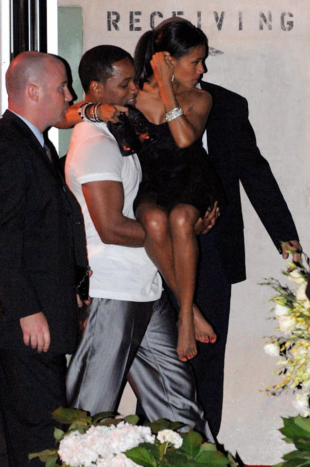 "Check out Will Smith's guns as he carries his tiny wife Jada out of the party. Team Beckham/<a href=""http://www.splashnewsonline.com"" target=""new"">Splash News</a> - July 22, 2007"