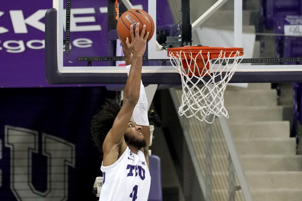 TCU guard PJ Fuller (4) goes up to dunk the ball in the first half of an NCAA college basketball game against North Dakota State in Fort Worth, Texas, Tuesday, Dec. 22, 2020. (AP Photo/Tony Gutierrez)