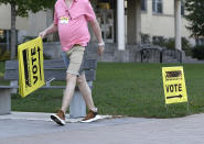 <p>An Elections Canada officer stakes out signs in Ottawa directing voters to a polling location for the Canadian general election on Monday, Sept. 20, 2021. THE CANADIAN PRESS/Justin Tang</p>