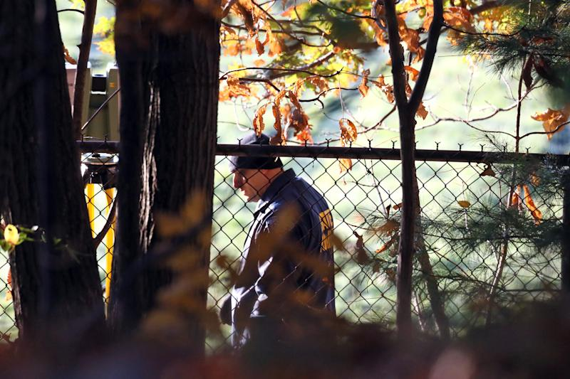 Massachusetts State Police detectives are seen at the Danvers High School, investigating a report of a sudden death inside the school, Wednesday, Oct. 23, 2013, in Danvers, Mass. A 14-year-old high school student is facing a murder charge in the death of a 24-year-old teacher found dead in the woods behind the school. Essex District Attorney Jonathan Blodgett on Wednesday identified the victim as Danvers High School teacher Colleen Ritzer, of Andover. (AP Photo/Boston Herald, Mark Garfinkel) BOSTON GLOBE OUT; METRO BOSTON OUT; MAGS OUT; ONLINE OUT; NO SALES; MANDATORY CREDIT