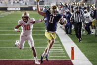 Notre Dame wide receiver Ben Skowronek (11) runs the ball in for a touchdown against Boston College defensive back Brandon Sebastian (10) during the first half of an NCAA college football game, Saturday, Nov. 14, 2020, in Boston. (AP Photo/Michael Dwyer)