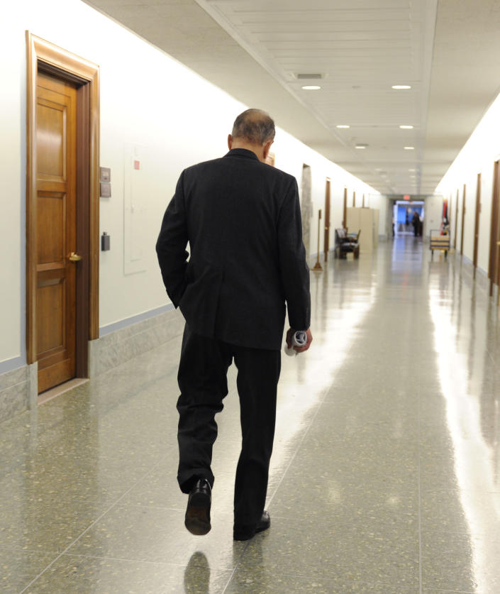 FILE - In this April 30, 2009 file photo former Republican Sen. Arlen Specter, D-Pa., walks down the hall of the Dirksen Senate office building after attending the Senate Appropriations Committee hearing on the FY2009 war supplemental on Capitol Hill in Washington. Former U.S. Sen. Arlen Specter, longtime Senate moderate and architect of one-bullet theory in JFK death, died Sunday, Oct. 14, 2012. He was 82. (AP Photo/Susan Walsh, File)