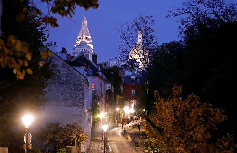 A street is seen in Montmartre few minutes before the nightly curfew due to restrictions against the spread of the coronavirus disease (COVID-19) in Paris