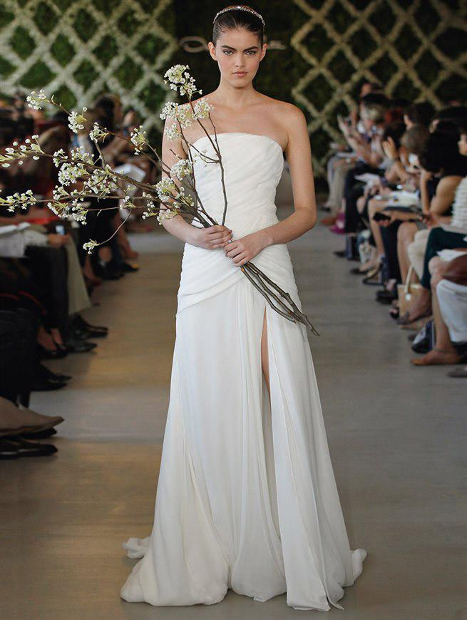 """At <a target=""_blank"" href=""http://www.luckymag.com/"">Lucky</a> we're always talking about staying true to your personal style, especially on your wedding day,"" notes the magazine's style editor, Lori Bergamotto. ""So, for Jennifer Aniston, this elegant Oscar de la Renta gown would hit the perfect note. It's simple but sexy (hello, up-to-there thigh slit); feminine but sophisticated; and the gentle draping gives it a Grecian goddess feel that's <em>very</em> Jen Aniston. Plus, her characteristically toned body would look beyond amazing in it."" <p><em>Follow Lori on Twitter <a target=""_blank"" href=""https://twitter.com/loribergamotto "">@loribergamotto</a>.</em> </p>"