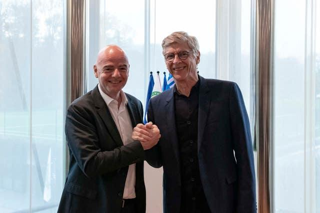 Wenger, right, with FIFA president Gianni Infantino