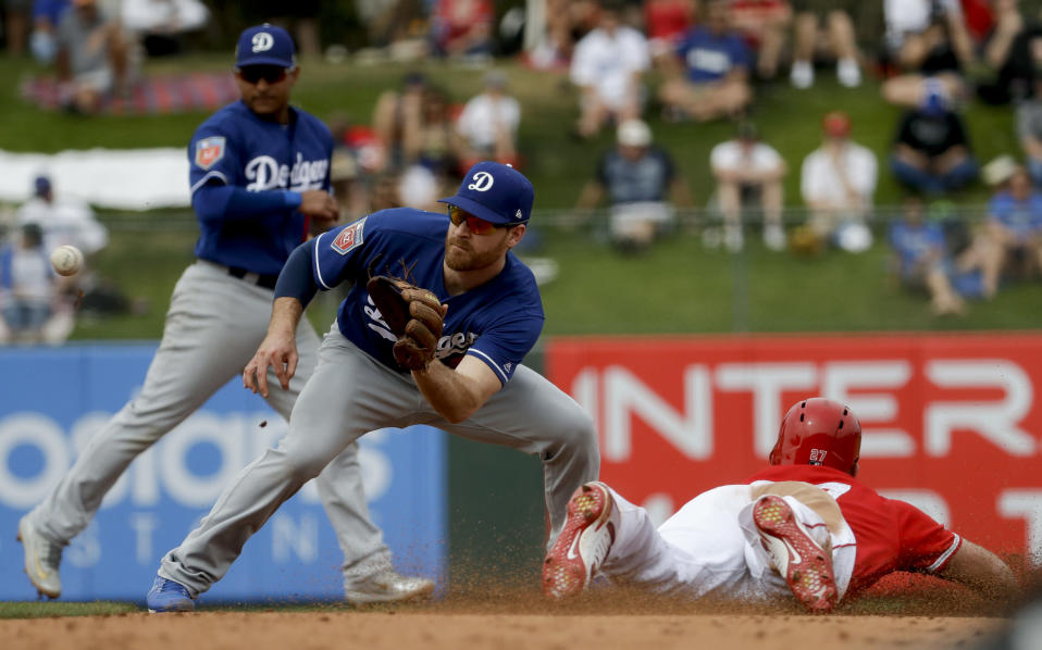 Los Angeles Angels' Mike Trout steals second past Los Angeles Dodgers second baseman Logan Forsythe during the fifth inning of a spring baseball game in Tempe, Ariz., Wednesday, March 7, 2018. (AP Photo/Chris Carlson)