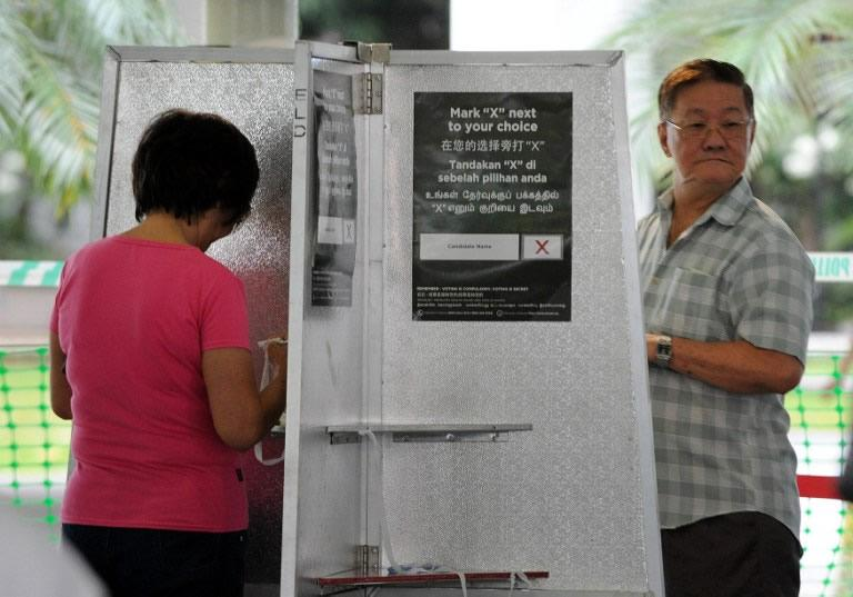 Voters in a Singapore suburb began casting ballots on January 26 in a by-election that tests the public mood two years after the ruling party suffered its worst ever poll performance.