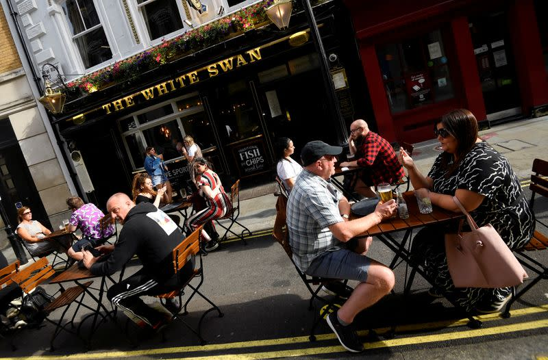UK consumer spending recovers in July as pubs and restaurants reopen