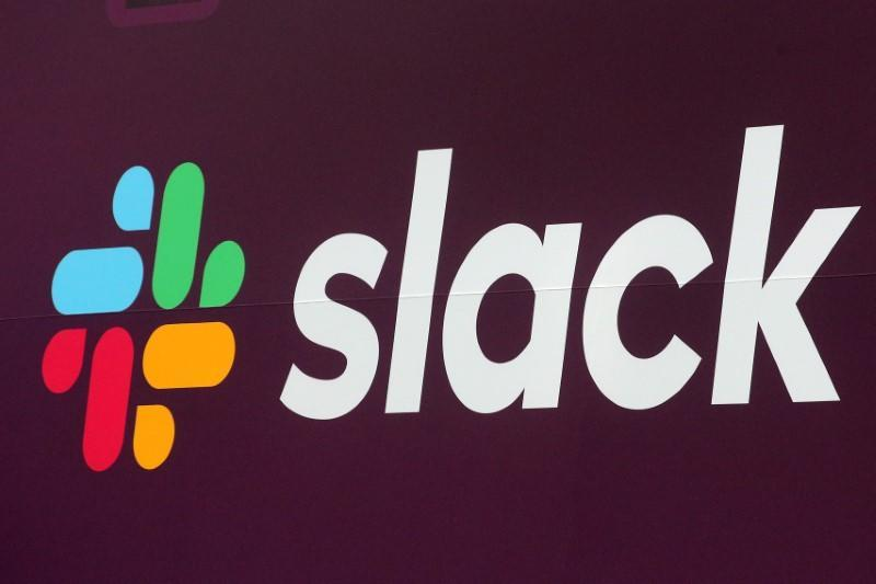 FILE PHOTO: The Slack Technologies Inc. logo is seen on a banner outside the New York Stock Exchange (NYSE) during thew company's IPO in New York
