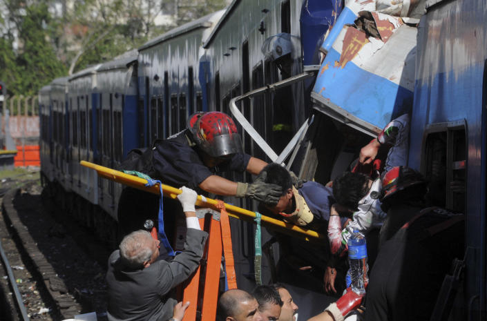 Firemen rescue wounded passengers from a commuter train after a collision in Buenos Aires, Argentina, Wednesday Feb. 22, 2012. A packed train slammed into the end of the line in Buenos Aires' busy Once station Wednesday, killing dozens and injuring hundreds, according to police. (AP Photo/Leonardo Zavattaro,Telam)