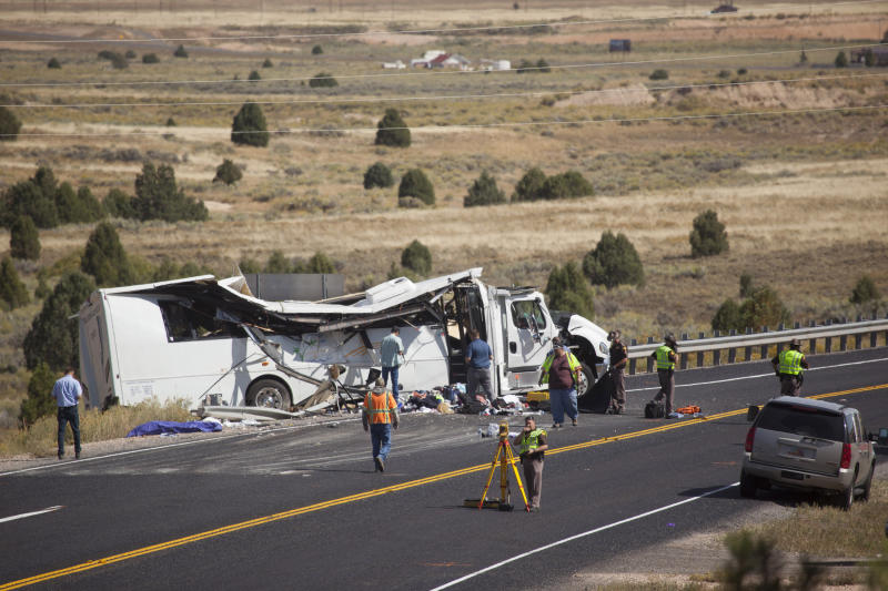 A tour bus has crashed near Bryce Canyon National Park in the US state of Utah. Pictured is the wreckage of the white tour bus at the side of the road surrounded by emergency services personnel.