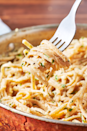 "<p>This alternative to the typically super-heavy dish is silky, flavorful, and seductive.</p><p>Get the recipe from <a href=""https://www.delish.com/cooking/recipe-ideas/recipes/a45568/skinny-alfredo-recipe/"" rel=""nofollow noopener"" target=""_blank"" data-ylk=""slk:Delish."" class=""link rapid-noclick-resp"">Delish.</a></p>"
