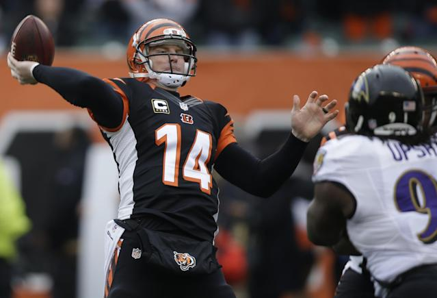 Cincinnati Bengals quarterback Andy Dalton throws a pass against the Baltimore Ravens in the first half of an NFL football game, Sunday, Dec. 29, 2013, in Cincinnati. (AP Photo/Al Behrman)