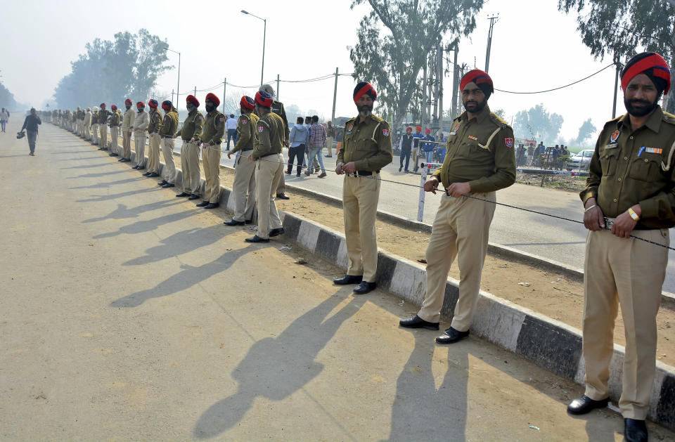 Indian policemen stand guard as they prepare to receive Indian pilot at India Pakistan border at Wagah, 28 kilometers (17.5 miles) from Amritsar, India, Friday, March 1, 2019. Pakistan is preparing to hand over a captured Indian pilot as shelling continued for a third night across the disputed Kashmir border even as the two nuclear-armed neighbors seek to defuse the most serious confrontation in two decades. (AP Photo/Prabhjot Gill)