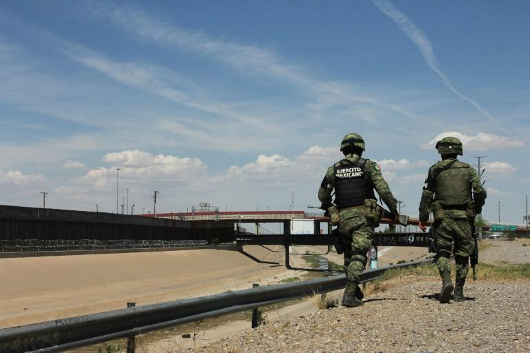 Members of the Mexican National Guard patrol the banks of the Rio Bravo river in Ciudad Juarez, Mexico, to prevent illegal crossings to El Paso, Texas (AFP Photo/HERIKA MARTINEZ)