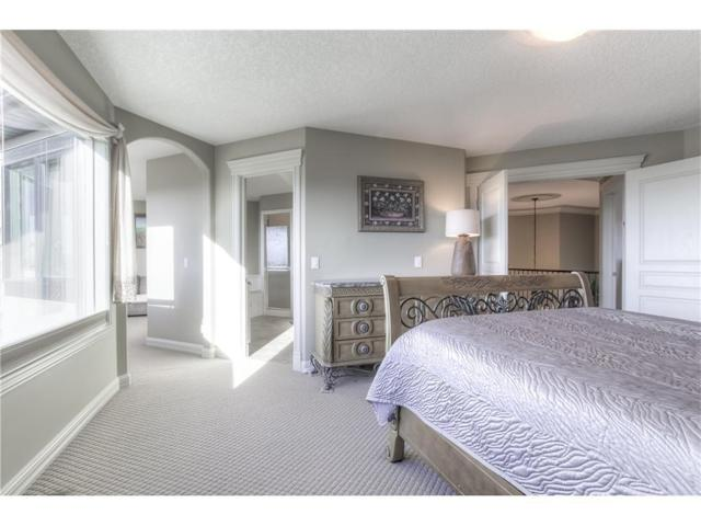 <p><span>299 Rocky Ridge Drive Northwest, Calgary, Alta.</span><br> There are five bedrooms in the home, including this spacious master suite with stunning views and a sitting area.<br> (Photo: Zoocasa) </p>