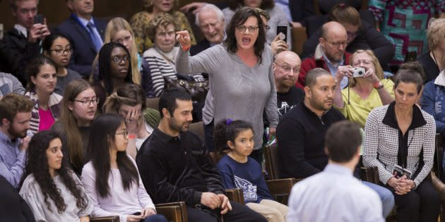 A woman heckles Prime Minister Justin Trudeau during a town hall event at Western University in London, Ont., on Jan. 11, 2018.