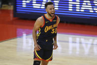 Golden State Warriors guard Stephen Curry yells after making a 3-point shot against Houston Rockets during the second half of an NBA basketball game in San Francisco, Saturday, April 10, 2021. (AP Photo/Jed Jacobsohn)
