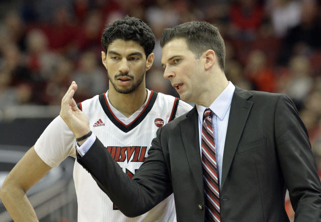Louisville interim head coach David Padgett talks to forward Anas Mahmoud during the second half of Louisville's win over George Mason on Sunday. (AP)