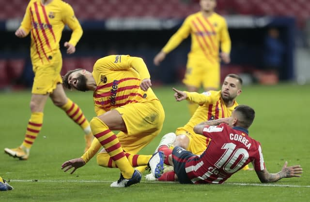 Gerard Pique, left, suffered a right knee sprain following this challenge with Angel Correa