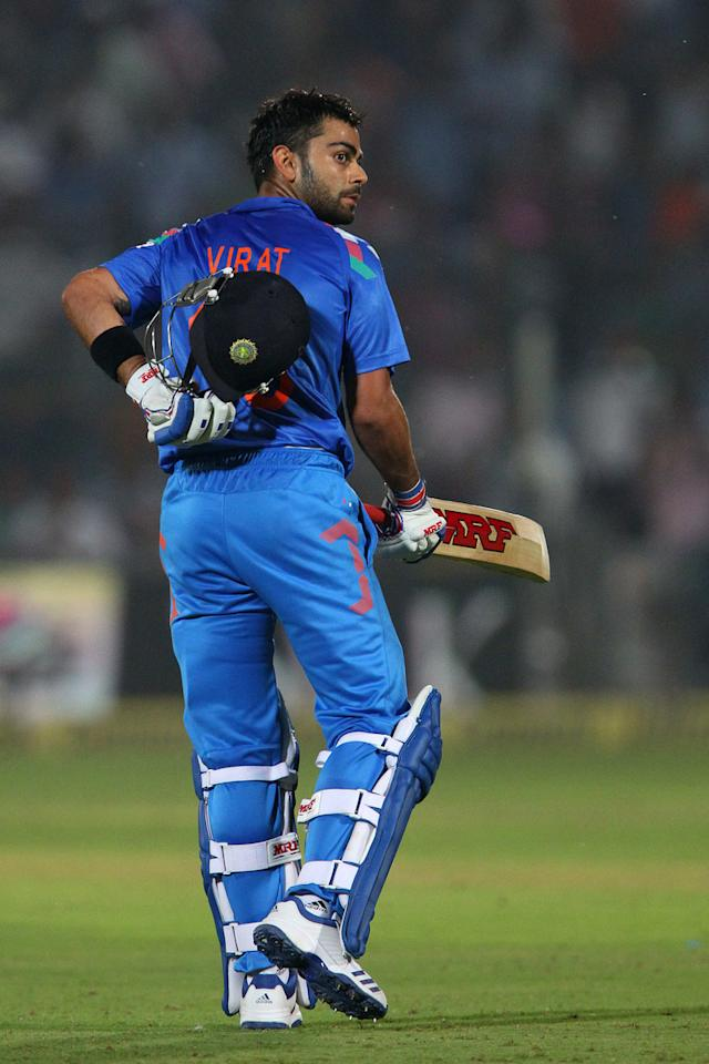 Virat Kohli of India celebrates his century during the 2nd One Day International (ODI) match in the Star Sports Series between India and Australia held at the Sawai Mansingh Stadium in Jaipur on the 16th October 2013
