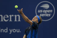 Alexander Zverev, of Germany, serves to Casper Ruud, of Norway, during the Western & Southern Open tennis tournament Friday, Aug. 20, 2021, in Mason, Ohio. (AP Photo/Aaron Doster)