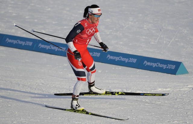 Marit Bjoergen captured her record 14th Winter Olympics medal on Wednesday with a bronze in the team ski sprint. (AP Photo/Kirsty Wigglesworth)