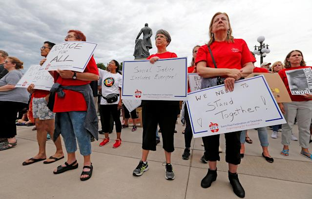 <p>Protesters hold signs in support of Philando Castile during a rally on the capitol steps after a jury found St. Anthony Police Department officer Jeronimo Yanez not guilty of second-degree manslaughter in the death of Castile, in St. Paul, Minnesota, U.S. June 16, 2017. (Eric Miller/Reuters) </p>