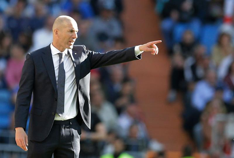 Real Madrid's coach Zinedine Zidane gestures during a Spanish La Liga soccer match between Real Madrid and Celta at the Santiago Bernabeu stadium in Madrid, Spain, Saturday, March 16, 2019.(AP Photo/Paul White)