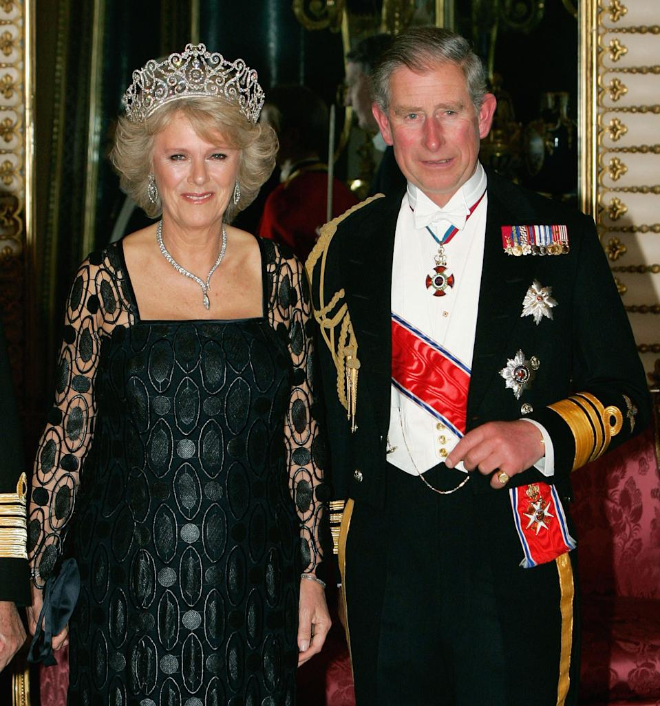 Camilla Duchess of Cornwall arrives in Royal heirloom diamond tiara, necklace and earrings, with Prince Charles The Prince of Wales at a banquet in Buckingham Palace on October 25, 2005 in London, England.