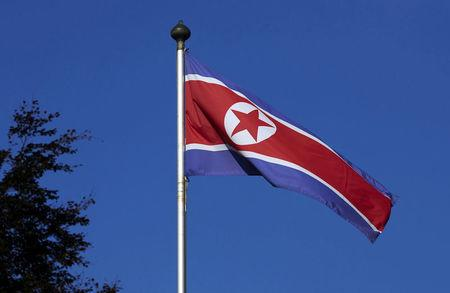 FILE PHOTO - North Korean flag flies on a mast at the Permanent Mission of North Korea in Geneva