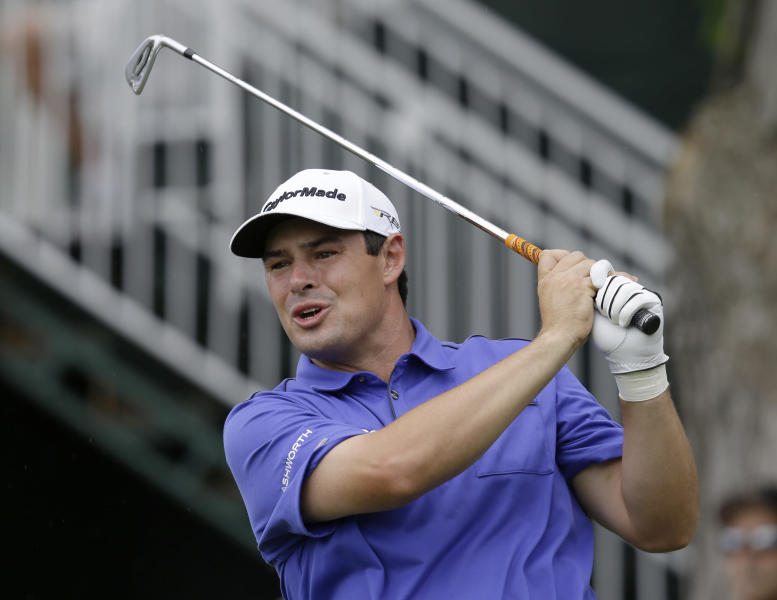 Johnson Wagner watches his tee shot on the 18th hole during the first round of the Greenbrier Classic PGA golf tournament in White Sulphur Springs, W.Va., Thursday, July 4, 2013. Wagner finished with an 8-under-par 62. (AP Photo/Steve Helber)