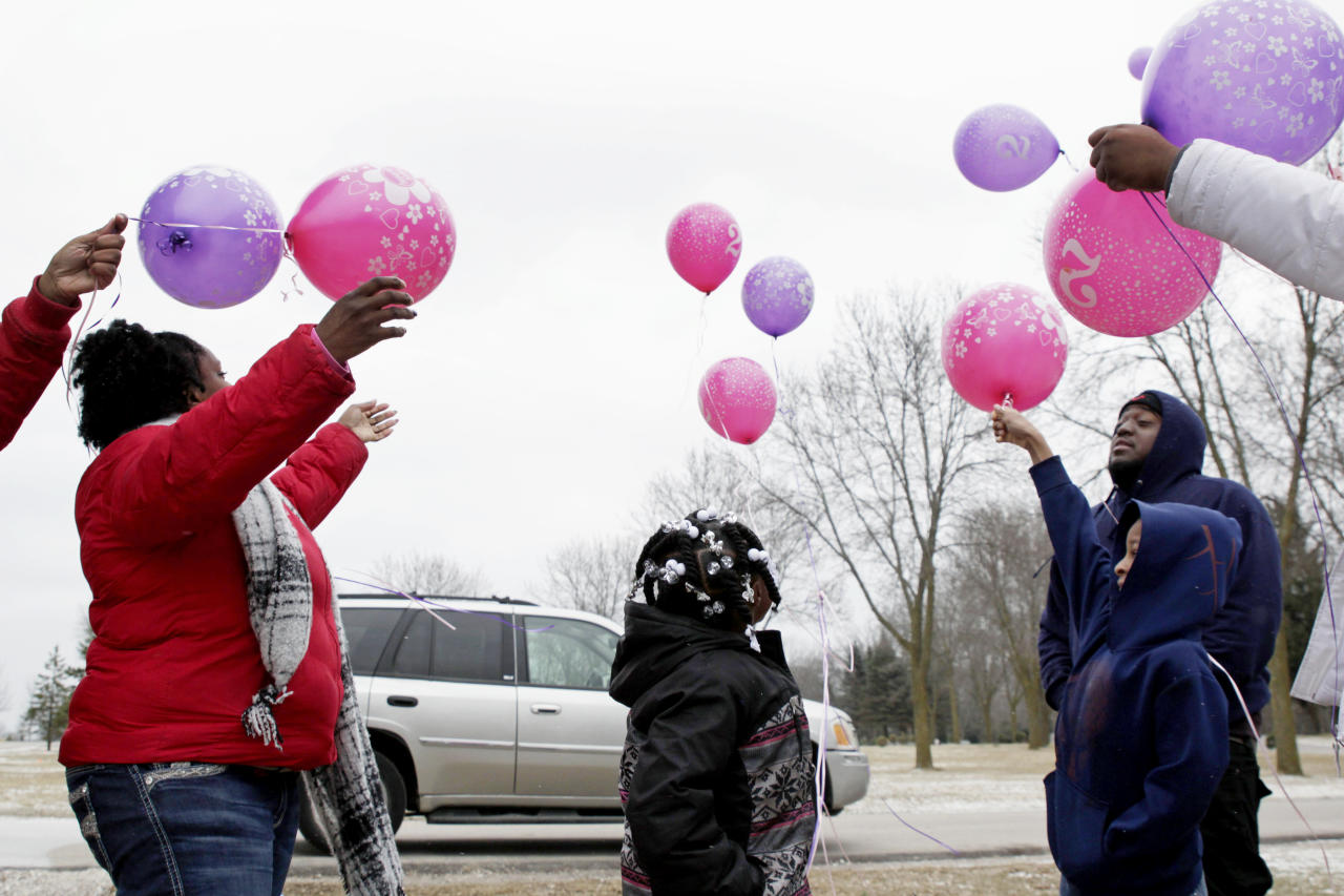 In this Jan. 27, 2017, photo, Helen Jackson, left, releases balloons at Graceland Cemetery in Milwaukee with her two children Romaine Ricks, right, and Raniah Ricks, center, and Jackson's boyfriend, Ralph Riner, in honor of what would have been her daughter, Cataleya Tamekia-Damiah Wimberly's 2nd birthday. Wimberly died in Feb. 2016 from a methadone overdose in a case the Milwaukee police are still investigating. The number of children's deaths is still small relative to the overall toll from opioids, but toddler fatalities have climbed steadily over the last 10 years. (AP Photo/Carrie Antlfinger)