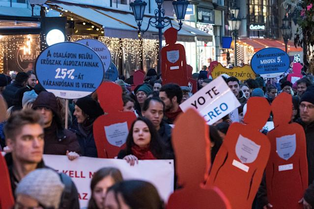 <p>Participants carry women-shaped cardboard cutouts during a demonstration marking the International Day for the Elimination of Violence Against Women in Budapest, Hungary, Nov. 25, 2017. (Photo: Marton Monus/EPA-EFE/REX/Shutterstock) </p>