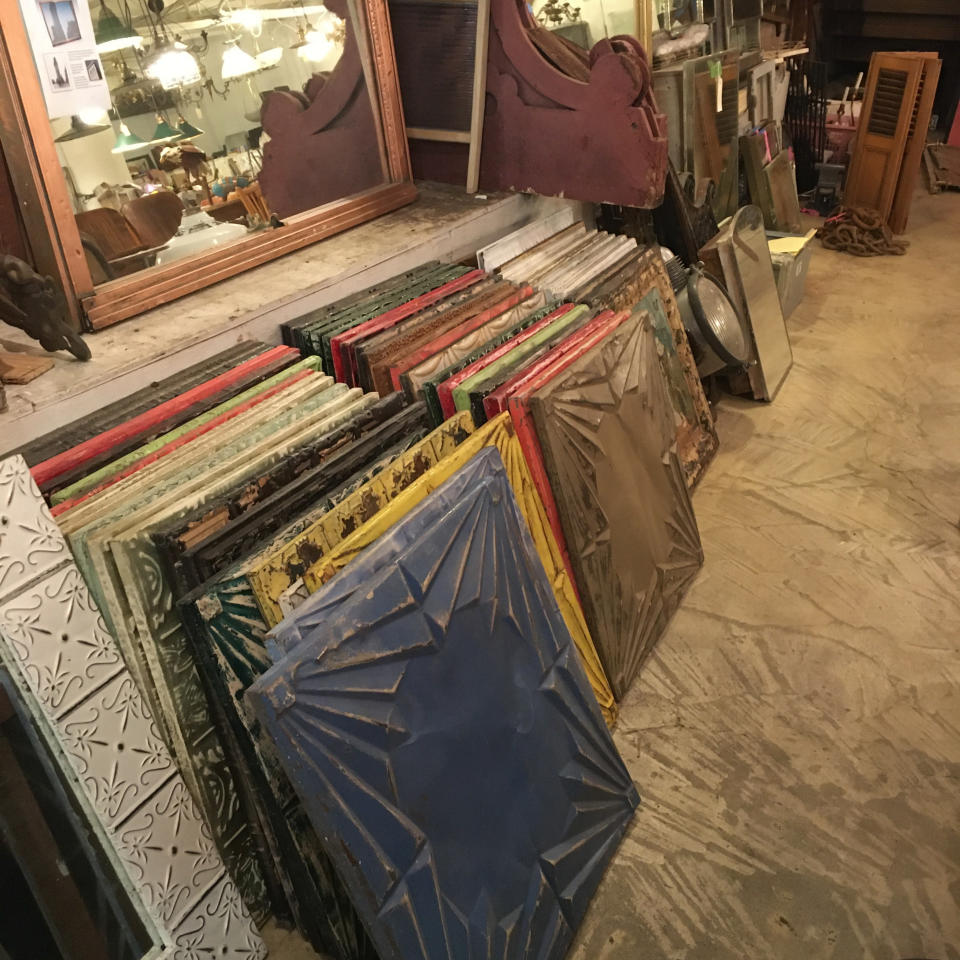 """This Oct. 15, 2019 photo shows a selection of salvaged tin ceiling tiles, available for sale at Olde Good Things salvage store in New York. Two of the hottest trends in home decor are sustainability and authenticity. """"It's about both history and sustainability,"""" says Madeline Beauchamp of Olde Good Things, one of the oldest architectural salvage businesses in the country, with one shop in Los Angeles, another in Scranton, Pennsylvania, two stores in New York, and a flagship store to open soon in Midtown Manhattan. (Katherine Roth via AP)"""