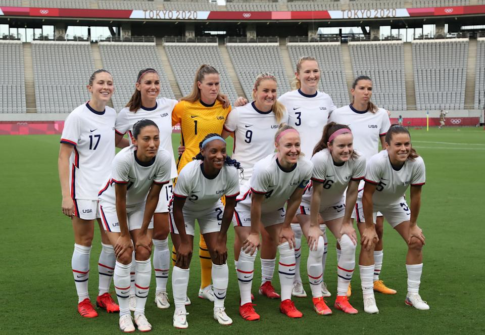 (From L, front) USA's forward Christen Press, USA's defender Crystal Dunn, USA's defender Becky Sauerbrunn, USA's midfielder Rose Lavelle, USA's defender Kelley O'Hara and (From L, Rear) USA's defender Abby Dahlkemper, USA's forward Alex Morgan, USA's goalkeeper Alyssa Naeher, USA's midfielder Lindsey Horan, USA's midfielder Samantha Mewis and USA's forward Tobin Heath pose for a team photo prior to the Tokyo 2020 Olympic Games women's group G first round football match between Sweden and USA at the Tokyo Stadium in Tokyo on July 21, 2021. (Photo by Yoshikazu TSUNO / AFP) (Photo by YOSHIKAZU TSUNO/AFP via Getty Images)