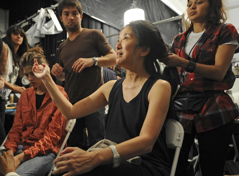 FILE - This Sept. 11, 2008 file photo shows fashion designer Vera Wang getting her hair done backstage before the showing of her spring 2009 collection during Fashion Week in New York. Wang, 63, was honored for her lifetime achievement by the Council of Fashion Designers at its star-studded awards show Monday night. She received the award from her former employer and mentor Ralph Lauren, and she received a standing ovation from her peers. (AP Photo/ Louis Lanzano, file)